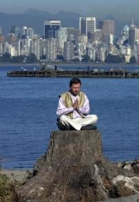 Eckhart Tolle on Tree Stump with Vancouver, B.C. background