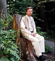 Eckhart Tolle sitting on a tree